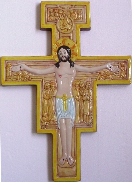 Varie misure su Croce in legno o in ceramica, in bassorilievo o dipinti.